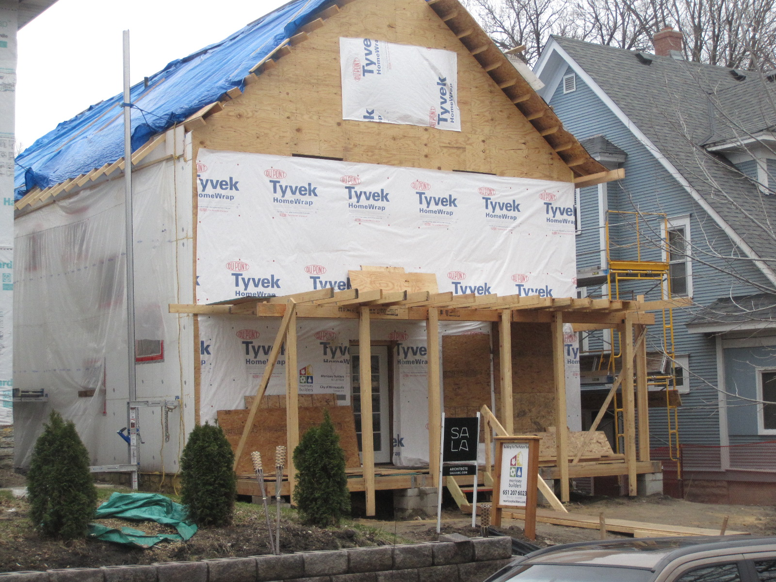 "fourth and fifth steps: apply 5/"" ply and Tyvek"