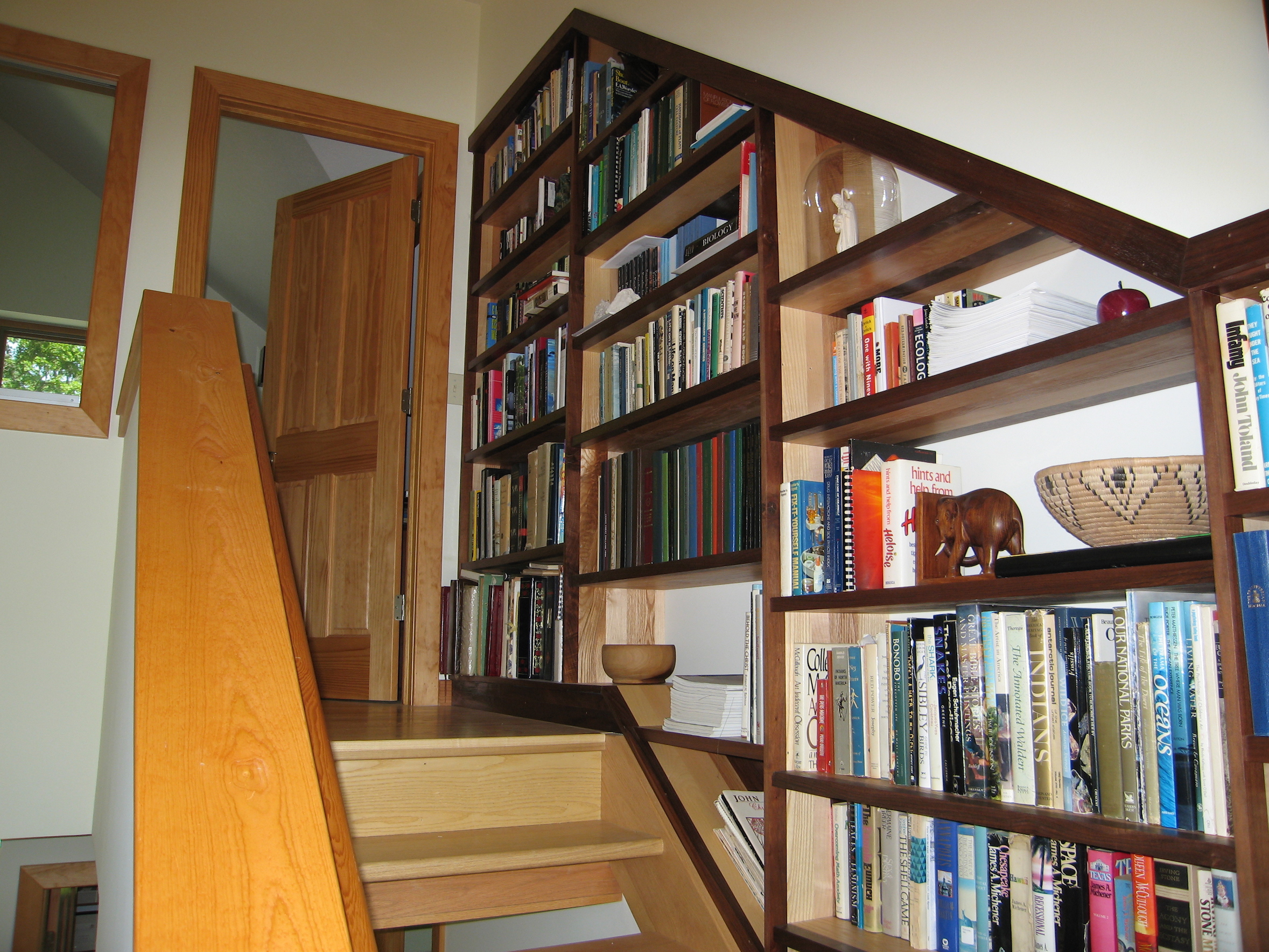 Trail Magic stairwell book cases; a positive energy home in Oberlin OH.