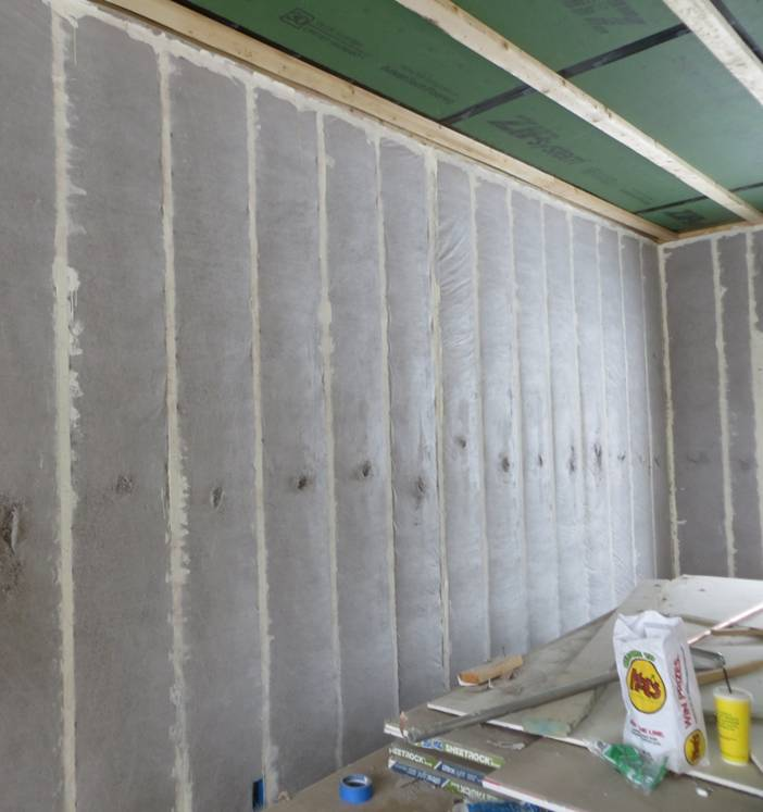 Cellulose filling double stud wall cavities