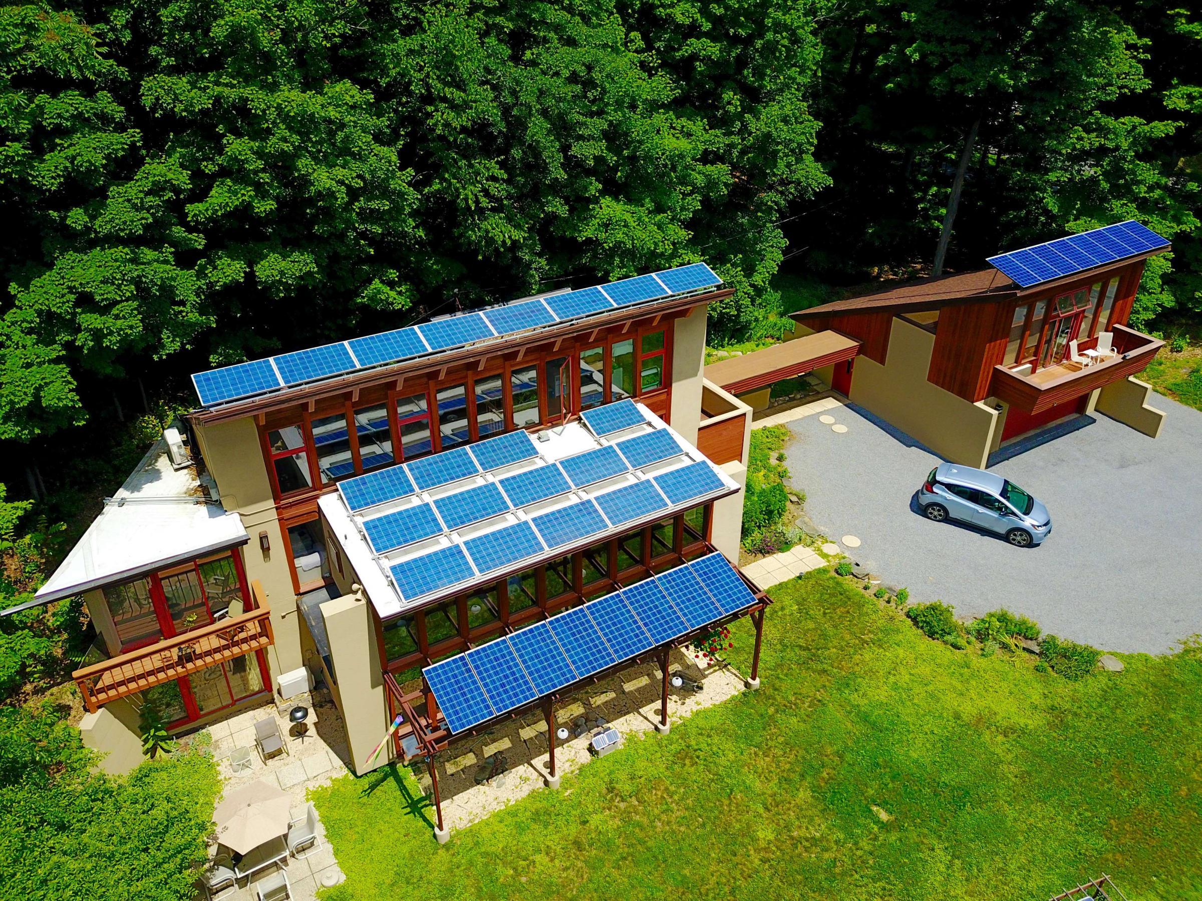 Helios passive active solar home net zero energy nesea for Active solar house plans