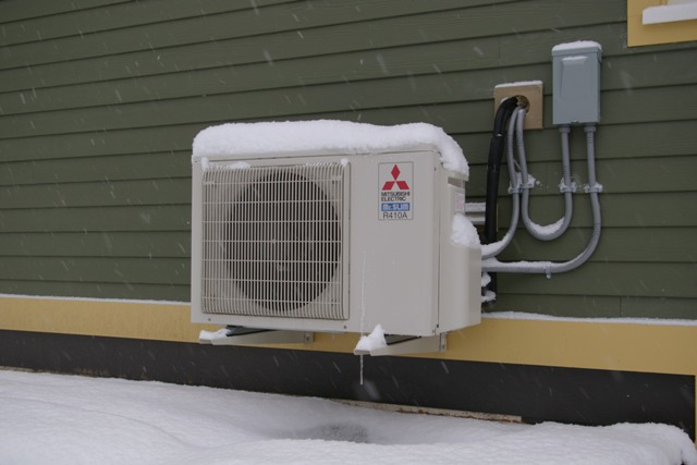A small heat pump provides heating and cooling for home