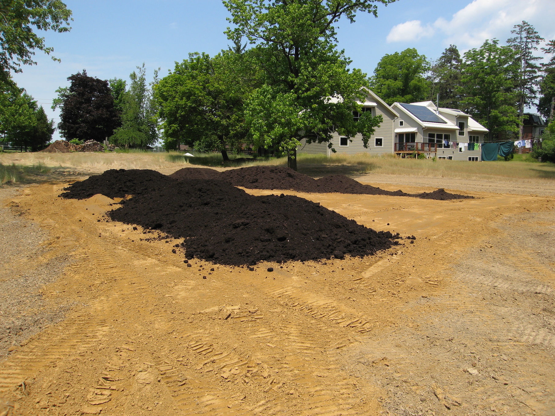 Trail Magic creating garden soil over heavy clay; a positive energy home in Oberlin OH.