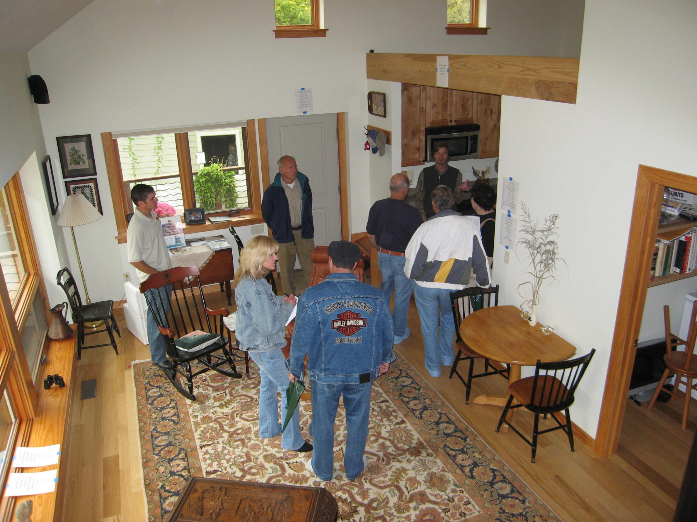 Trail Magic a tour group in the living-dining room; a positive energy home in Oberlin OH.