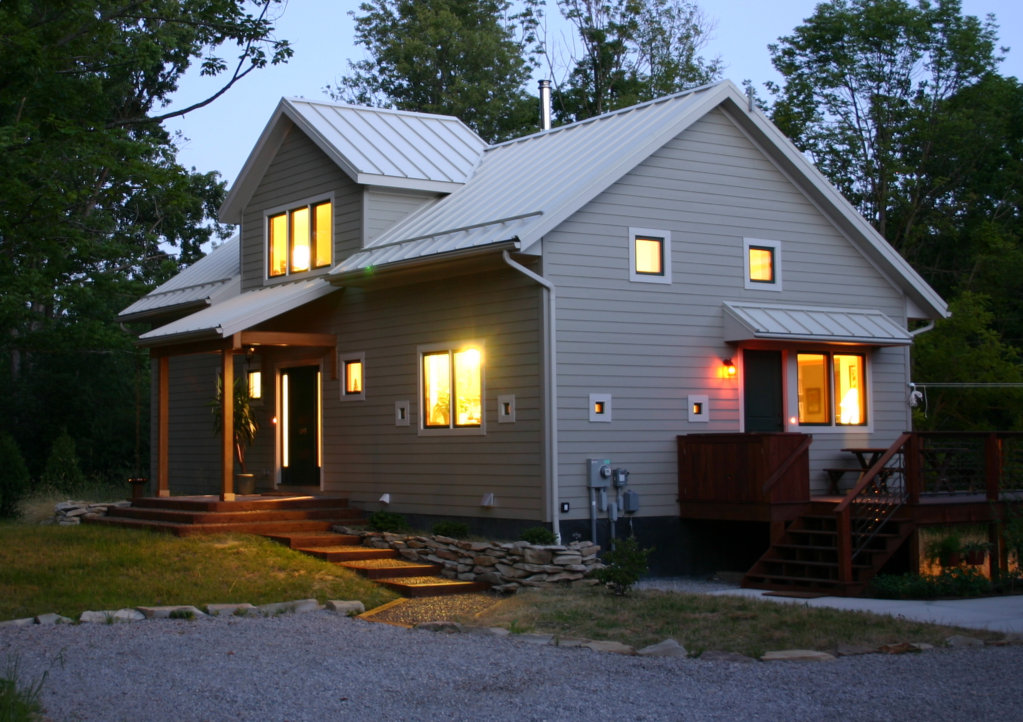 Trail Magic at night showing N and W sides; a positive energy home in Oberlin OH (photo Joe Ferut Ferut Architects)