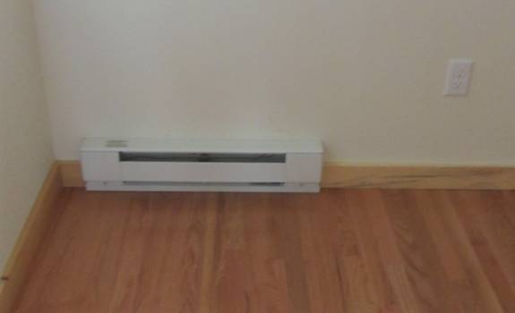 Small baseboards provide heat