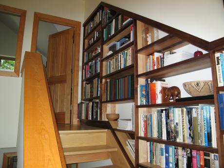 Trail Magic, stairwell book cases; a positive energy home in Oberlin, OH.