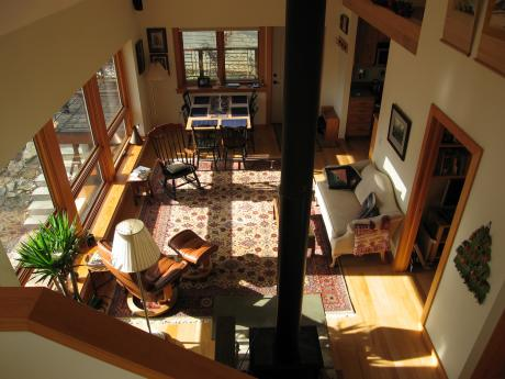 Trail Magic, living-dining room from stair landing; a energy positive energy home in Oberlin, OH.