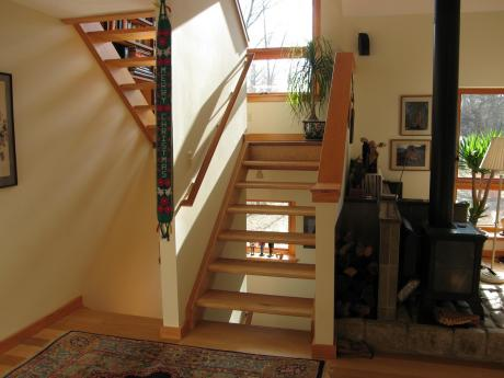 Trail Magic, open riser stairway to study; a energy positive energy home in Oberlin, OH.