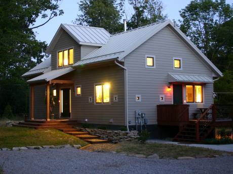 Trail Magic at night showing N and W sides; a positive energy home in Oberlin, OH (photo, Joe Ferut, Ferut Architects)