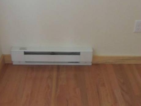 Small baseboards provide heat