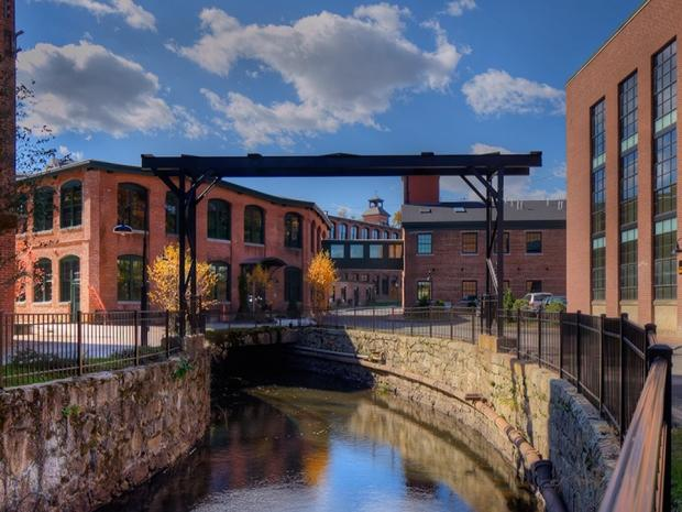 Exterior shot of Abbot Mill Complex, featuring canal