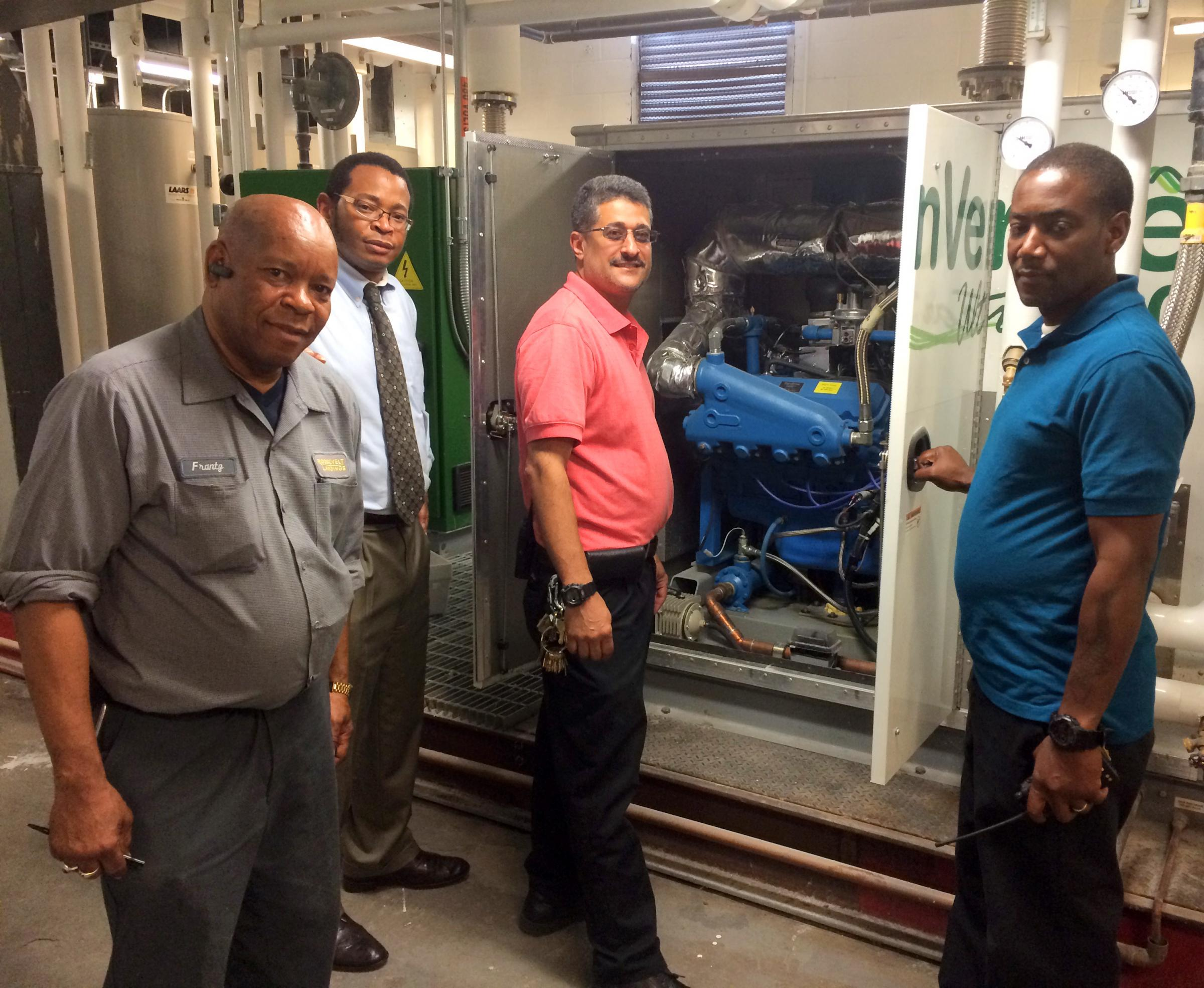 A TEAM INSPECTS hvAC EquIPMENT AT RooSEvELT LANDINgS oN JuNE 20, 2014.